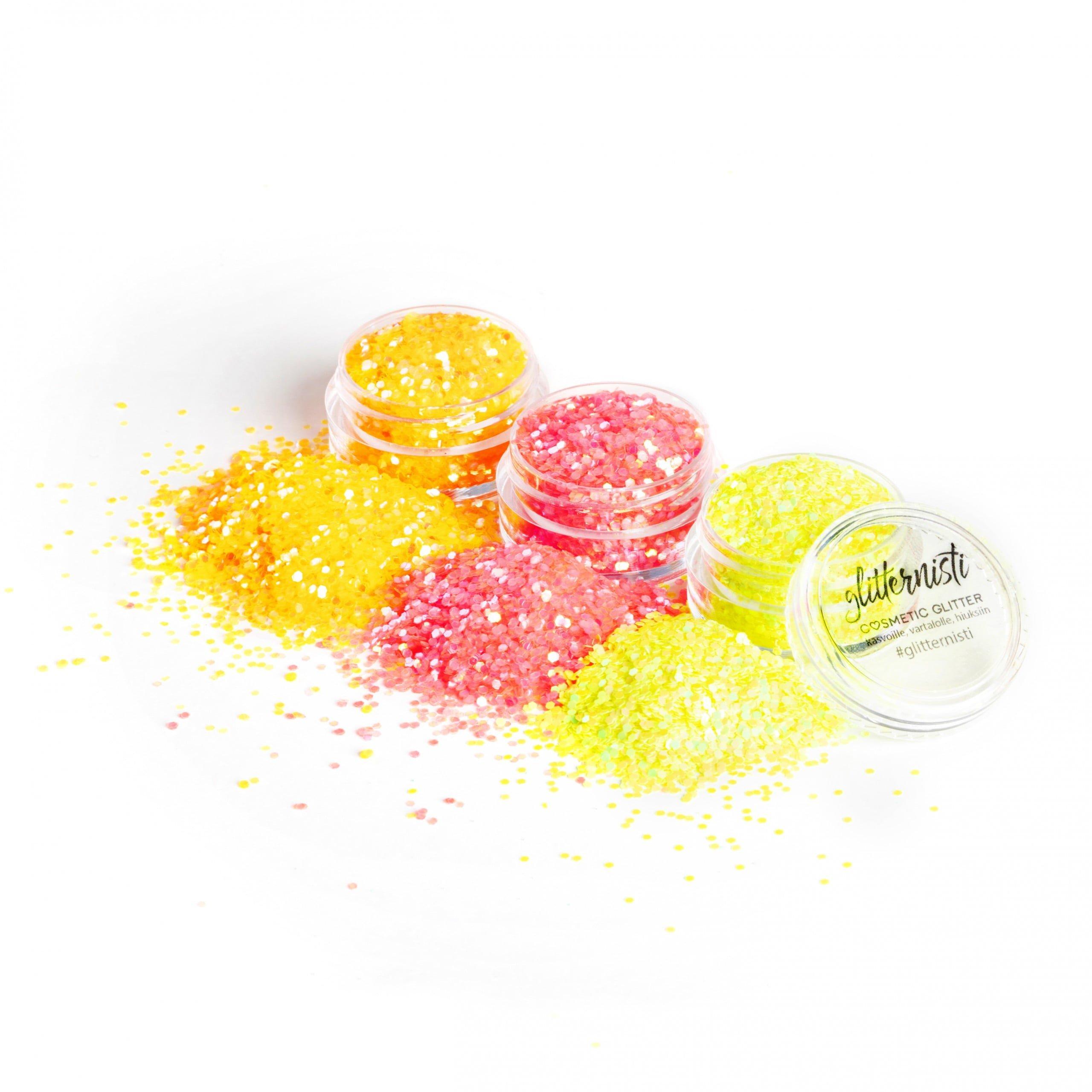 Neon glittersetti sisältää kolme kosmetiikka glitteriä.