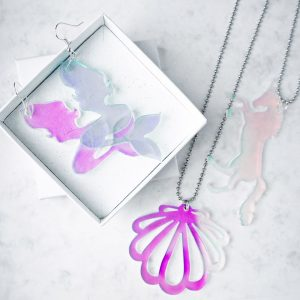 Mermaid earrings and pendant made from iridescent acrylic.