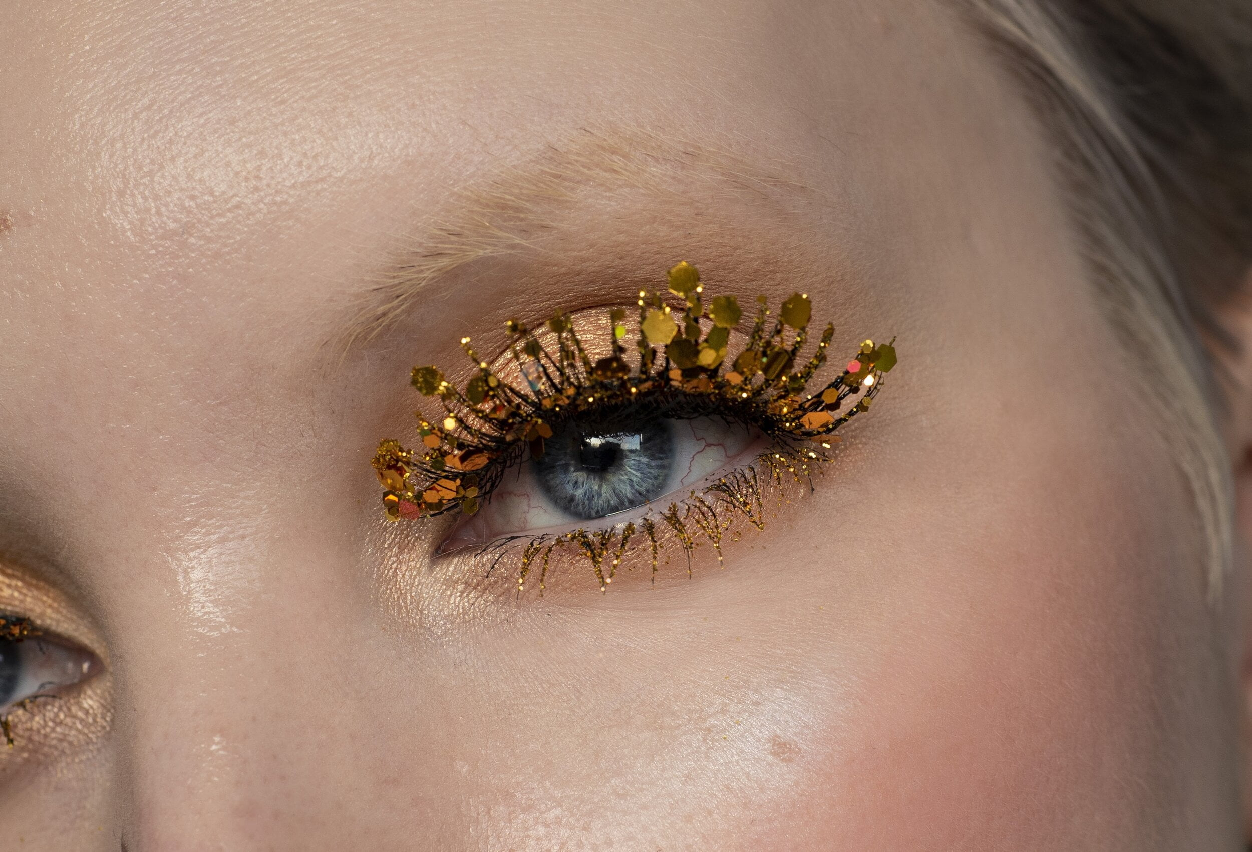 DIY glitter lashes on woman.